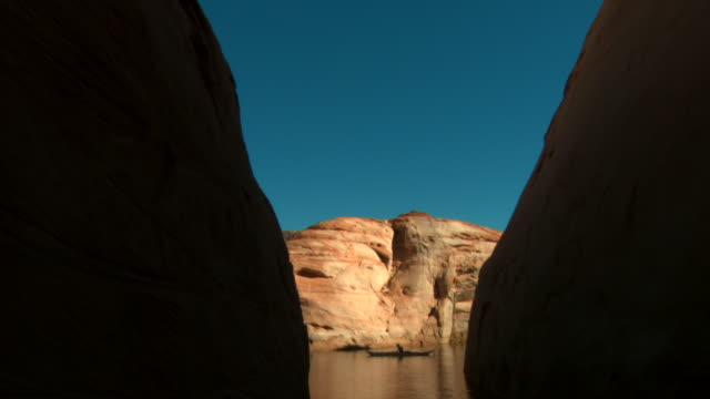 ms, cs, silhouette of lone kayaker on lake powell, mountains in background, glen canyon national recreation area, utah, usa - boat point of view stock videos & royalty-free footage