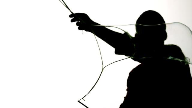 silhouette of man blowing giant bubble - jätte uppdiktad figur bildbanksvideor och videomaterial från bakom kulisserna