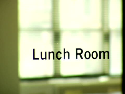 ms, selective focus, silhouette of man entering and leaving lunch room in office - canteen stock videos & royalty-free footage
