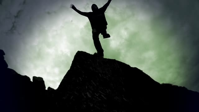 silhouette of man jumping off rocks, super slow motion - in silhouette stock videos & royalty-free footage