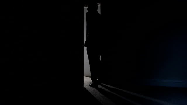 silhouette of man leaving dark room. - leaving stock videos & royalty-free footage