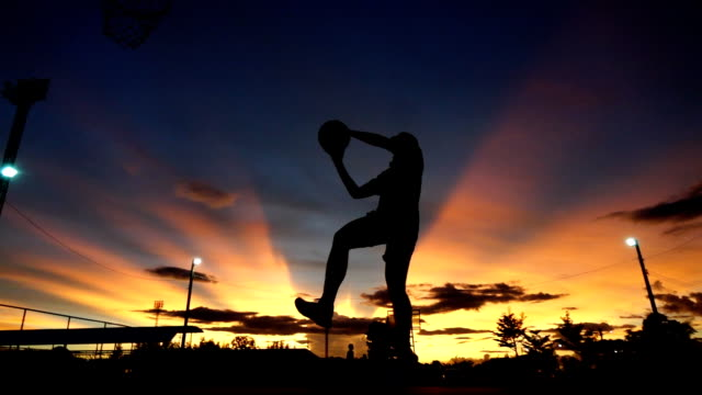 silhouette of man playing basketball,slow motion - wide stock videos & royalty-free footage