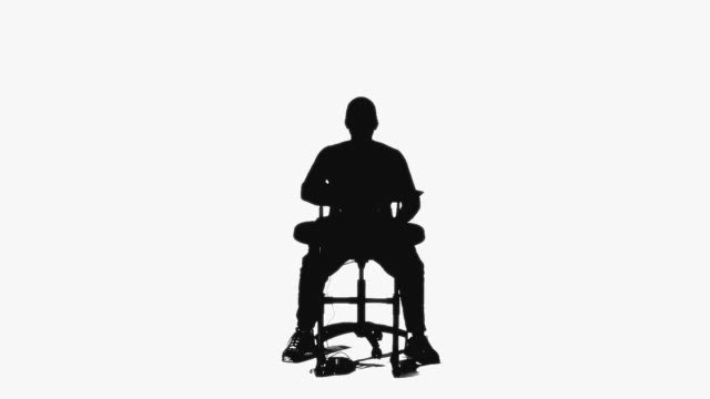 CGI Silhouette of man playing drums on white background