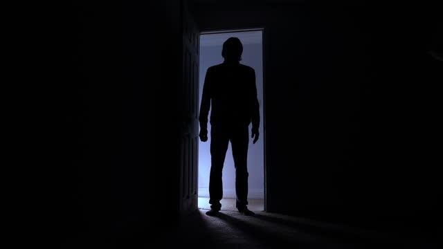 silhouette of man standing in doorway - opens door - silhouette stock videos & royalty-free footage
