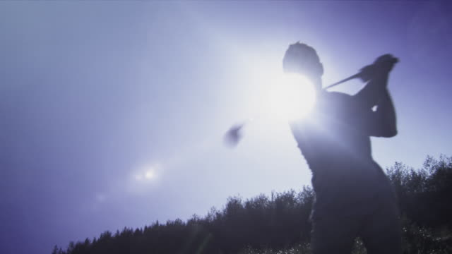 ms silhouette of man swinging golf club / squamish, british columbia, canada. - golf swing silhouette stock videos & royalty-free footage