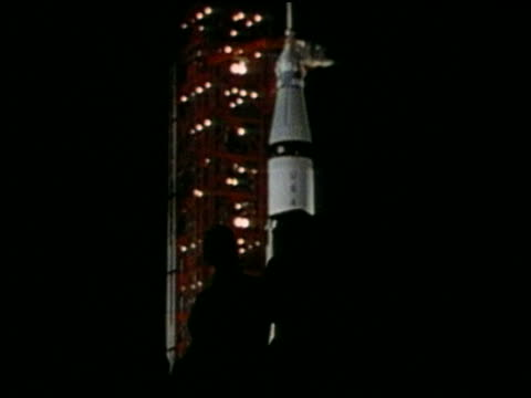 silhouette of men walking with rocket on launch pad in background - atmosphere filter stock videos & royalty-free footage