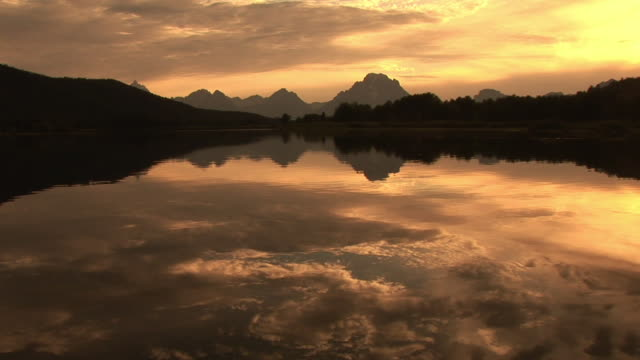 WS, Silhouette of mountain range and Snake river at sunset, Grand Teton National Park, Wyoming, USA