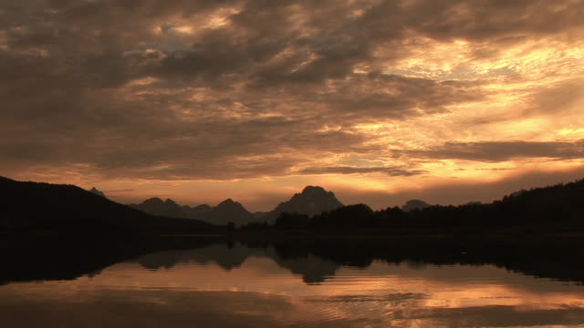 ws, silhouette of mountain range and snake river at sunset, grand teton national park, wyoming, usa - snake river stock videos and b-roll footage