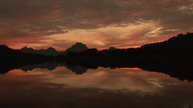 ws, pan, silhouette of mountain range and snake river at sunset, grand teton national park, wyoming, usa - snake river stock videos and b-roll footage