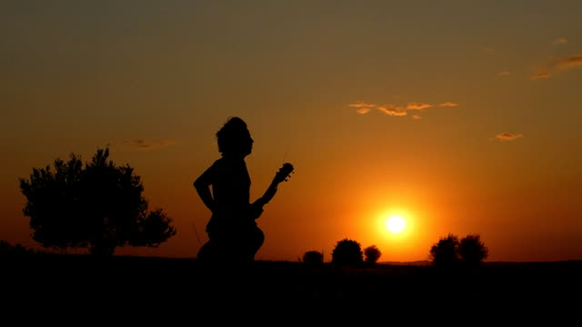 silhouette of musician running at  twilight time - poetry stock videos & royalty-free footage