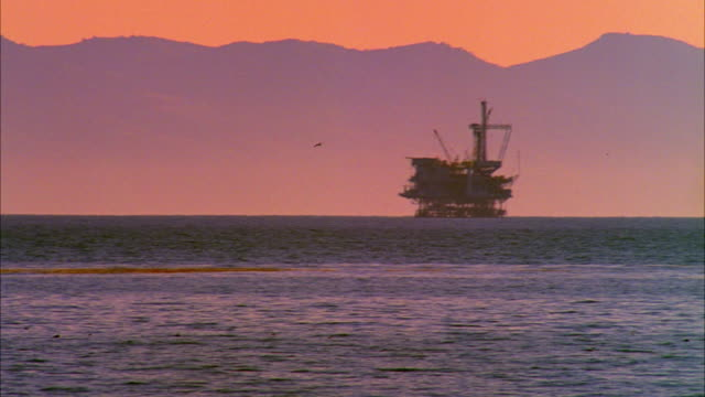 ws silhouette of off-shore oil platform at sunset with santa rosa island in background, goleta, california, usa - dramatic sky stock videos & royalty-free footage