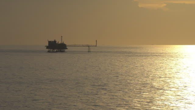 Silhouette of offshore oil production platform