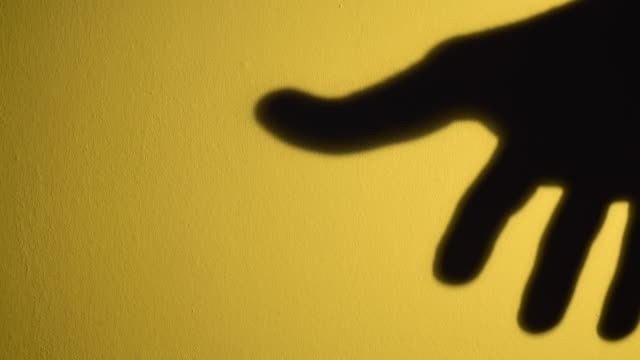 silhouette of open human hand moving in circle.   witchcraft and spells - übersinnliches stock-videos und b-roll-filmmaterial