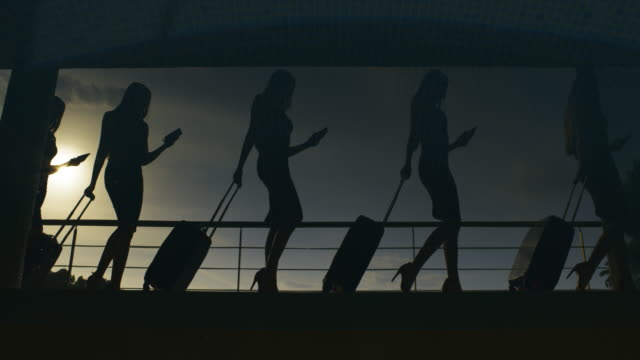 silhouette of people at airport, rush hours - luggage stock videos & royalty-free footage