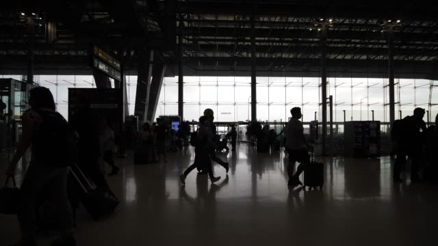 Silhouette of people on Departure