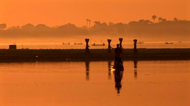 silhouette of people walking in inle lake, myanmar - myanmar stock videos & royalty-free footage