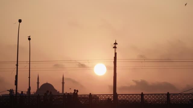 silhouette of people walking in istanbul - international landmark stock videos & royalty-free footage