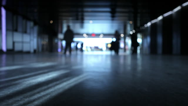 vídeos de stock e filmes b-roll de silhouette of people walking inside - 50 segundos ou mais