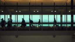 Silhouette of people who are embarking on a flight in Rome airport.