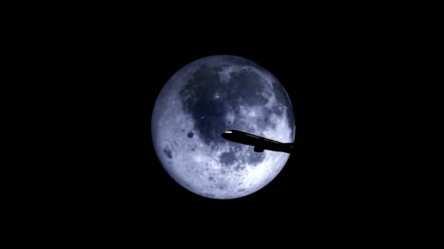 silhouette of plane passing over super moon - symmetry stock videos & royalty-free footage
