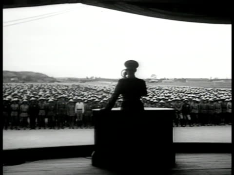 silhouette of president of republic of china chiang kaishek talking at podium chinese soldiers bg ls soldiers lined up formosa aka taiwan - chiang kai shek stock-videos und b-roll-filmmaterial