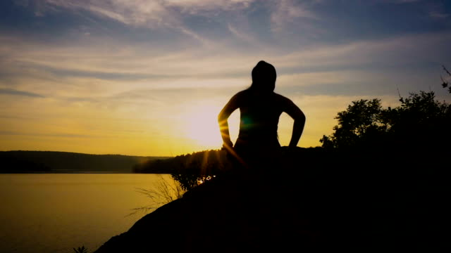 silhouette of runner woman athlete training outdoors exercising celebrating arms up on mountain at sunset or success, winning and achievement concept - reaching stock videos and b-roll footage