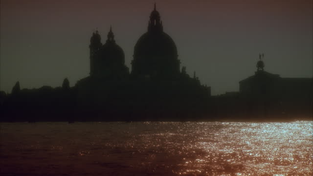 ms silhouette of santa maria della salute church by grand canal at sunset, venice, italy - grand canal venice stock videos & royalty-free footage