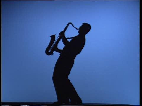 silhouette of saxophone player - saxophone stock videos and b-roll footage