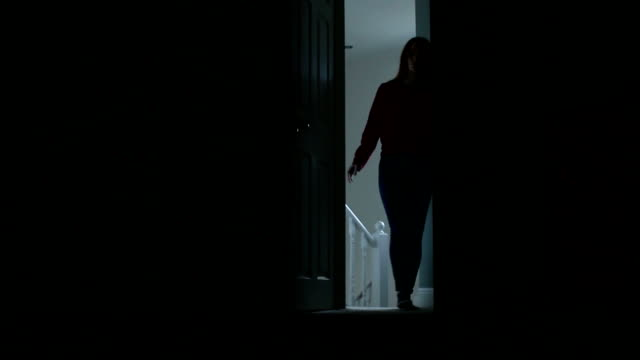 silhouette of slim young female entering a dark room. - bedroom stock videos & royalty-free footage