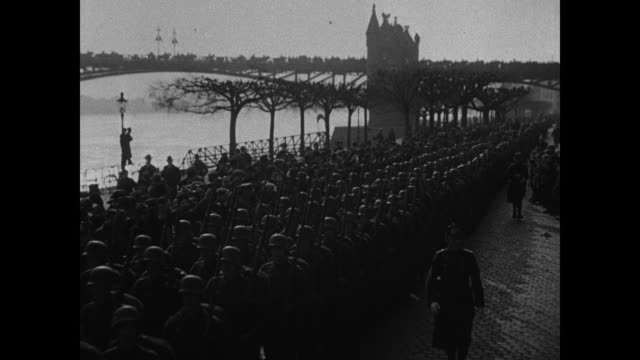silhouette of soldier sentry standing in doorway holding rifle german wwi soldiers marching in street italian soldiers walking on hill japanese... - world war one stock videos & royalty-free footage