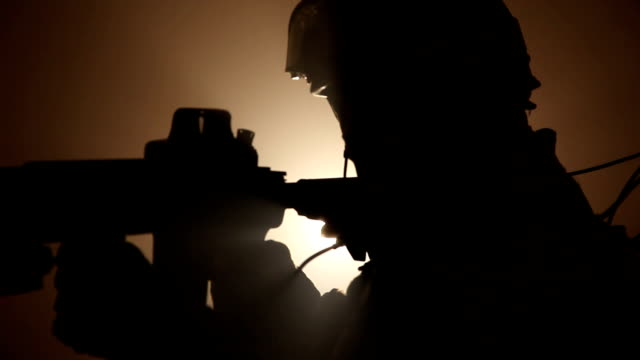 cu, focusing, silhouette of special forces operator in full protection gear with assault rifle, tampa, florida, usa - one mid adult man only stock videos & royalty-free footage