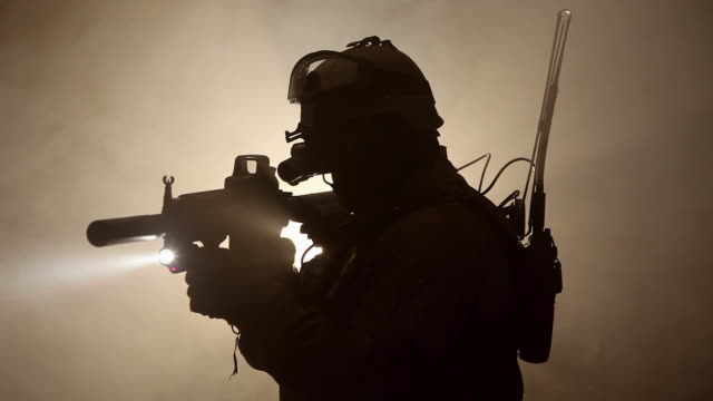 MS, Silhouette of Special Forces Operator in full protection gear with assault rifle, Tampa, Florida, USA
