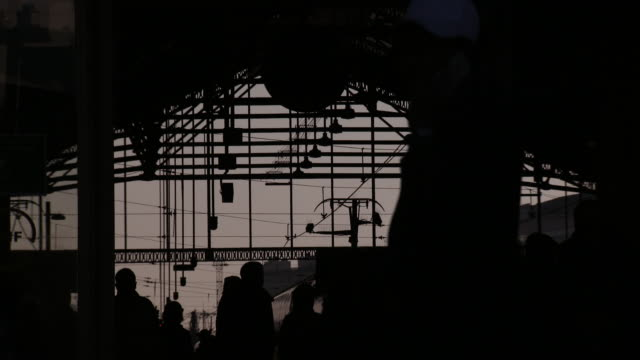 Silhouette of station architecture and people walking inside Paris Gare de Lyon station