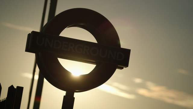 CU Silhouette of subway roundel against sunset sky, Epping Underground Station / London, England, United Kingdom