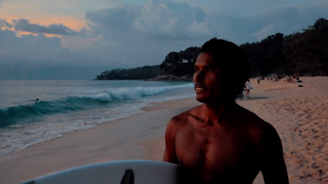 silhouette of surfer man on the beach - indonesia beach stock videos & royalty-free footage