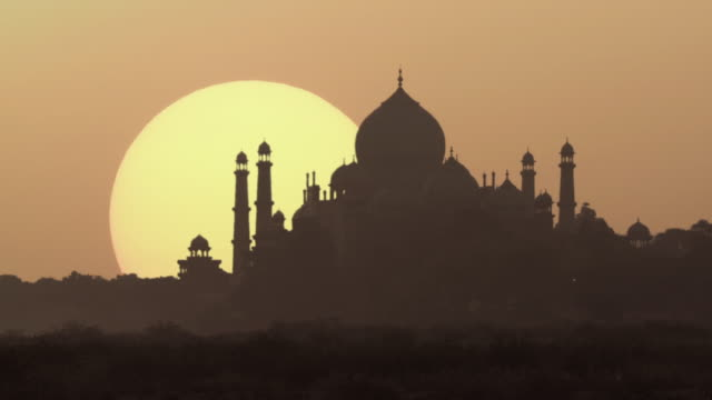 HIGH SPEED WS Silhouette of Taj Mahal at sunrise / Agra, Uttar Pradesh, India
