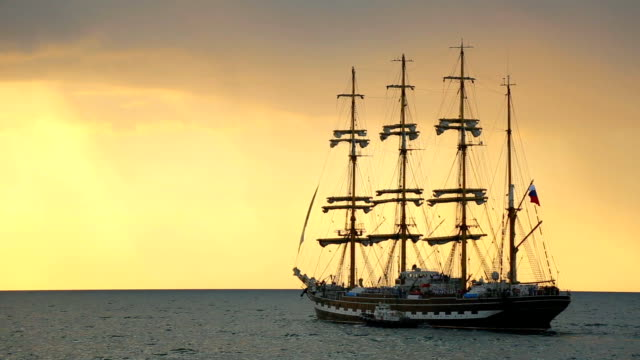 silhouette of the ancient sailing ship at sunset - sailing ship stock videos & royalty-free footage