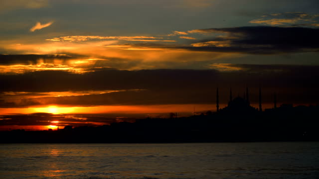 silhouette of the blue mosque at sunset - blue mosque stock videos and b-roll footage