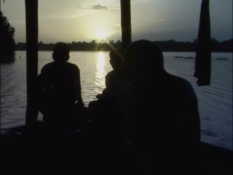 silhouette of three people boating in a river - unknown gender stock videos & royalty-free footage