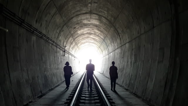 silhouette of three person in train tunnel - silhouette stock videos & royalty-free footage