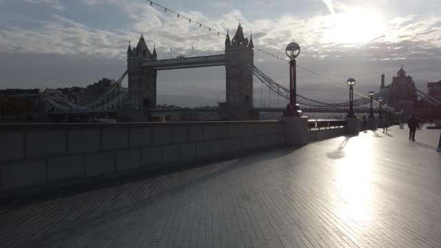 silhouette of tower bridge in sunlight, city of london, london, england, u.k., on monday, september 28, 2020. the government has imposed new measures... - reflection stock videos & royalty-free footage