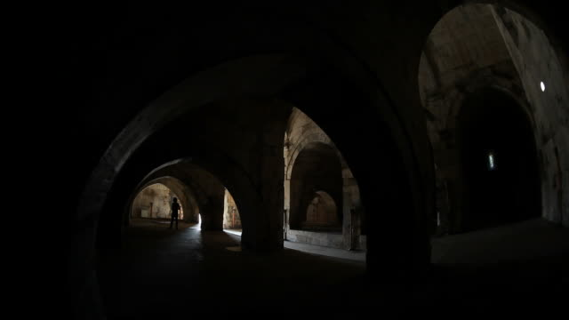 Silhouette Of Traveller Man Photographing In Susuz Caravanserai