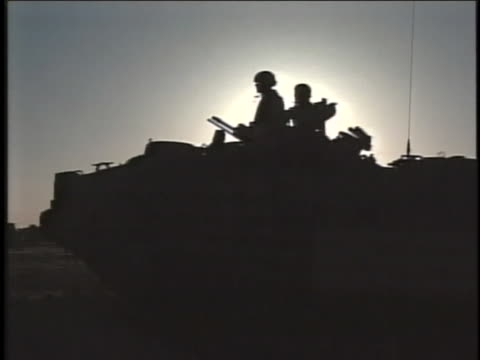 silhouette of two soldiers atop a military land vehicle. - al fallujah stock videos & royalty-free footage