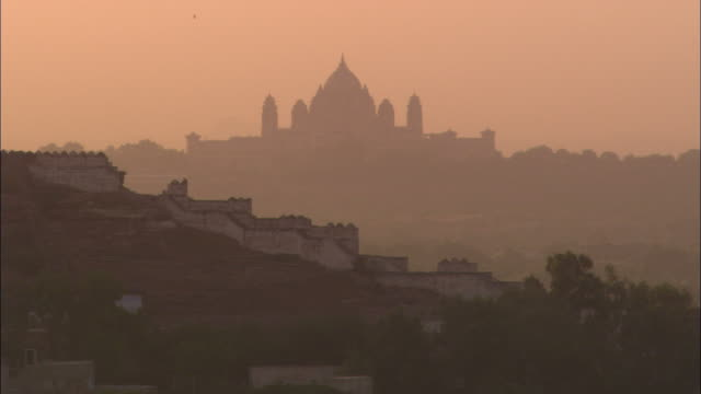ms, silhouette of umaid bhawan palace with buildings in foreground, jodhpur, rajasthan, india - palace stock videos & royalty-free footage
