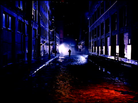 silhouette of unidentifiable hooded male jogging toward frame on empty plymouth street, punching, red light cast on cobblestone st. fg, mist bg,... - cobblestone stock videos & royalty-free footage