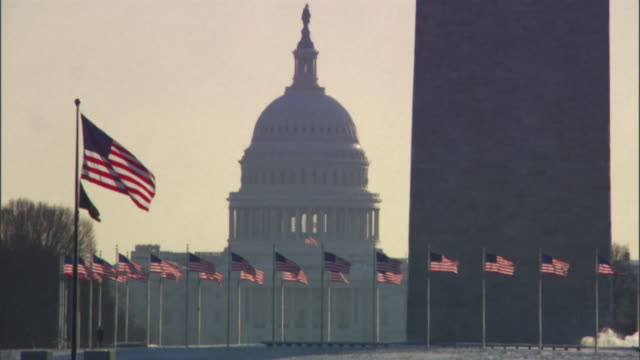 ms, silhouette of united states capitol dome with washington monument in foreground, washington dc, usa - washington monument stock videos & royalty-free footage