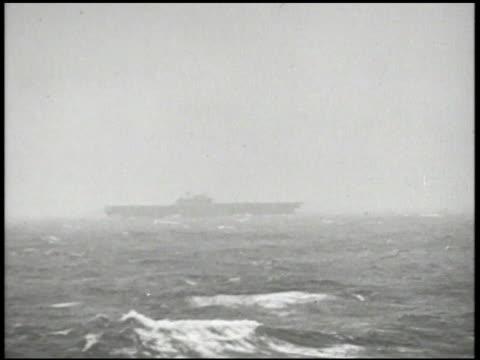silhouette of united states navy aircraft carrier uss enterprise aka 'big e' at sea vs captain william 'bull' halsey jr aka 'bill' in raincoat... - william halsey stock-videos und b-roll-filmmaterial