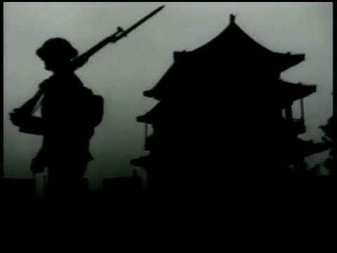 Silhouette of US Marine patrolling Chinese temple Peking Beijing China WWII