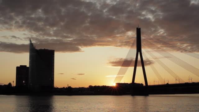 WS Silhouette of Vansu bridge over Daugave river during sunset / Riga, Latvia