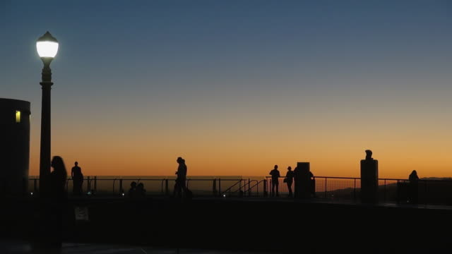 silhouette of visitors at griffith observatory - griffith observatory stock videos & royalty-free footage